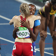 Athletics - Olympics: Day 13  Dalilah Muhammad of the United States is congratulated after winning the gold medal in the Women's 400m Hurdles Final by Sara Petersen of Denmark who won the silver medal at the Olympic Stadium on August 18, 2016 in Rio de Janeiro, Brazil. (Photo by Tim Clayton/Corbis via Getty Images)
