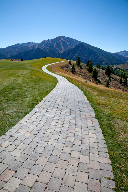 Sun Valley Golf Cart paver path leads back to Baldy Mountain from the White Clouds 9 golf course at Sun Valley Resort in Idaho on a perfect summer day.  Licensing and Open Edition Prints.