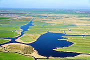 Nederland, Noord-Holland, Landsmeer, 20-04-2015; Ilperveld met veenplas Oostkerkebreek in de voorgrond, Purmerend rechts aan de horizon. Het veenweidegebied is eigendom is van de stichting Landschap Noord-Holland, Natura 2000 gebied.<br /> Nature reserve north of Amsterdam.<br /> luchtfoto (toeslag op standard tarieven);<br /> aerial photo (additional fee required);<br /> copyright foto/photo Siebe Swart