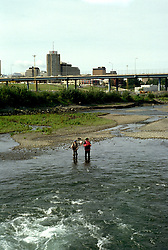 Alaska: Anchorage. Fishing for salmon. Photo akanch103..Photo copyright Lee Foster, 510/549-2202, lee@fostertravel.com, www.fostertravel.com