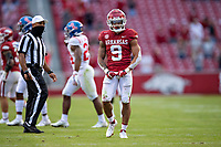 FAYETTEVILLE, AR - OCTOBER 17:    Greg Brooks Jr. #9 of the Arkansas Razorbacks flexes his muscle after making a tackle during a game against the Mississippi Rebels at Razorback Stadium on October 17, 2020 in Fayetteville, Arkansas.  The Razorbacks defeated the Rebels 33-21.  (Photo by Wesley Hitt/Getty Images) *** Local Caption *** Greg Brooks Jr.