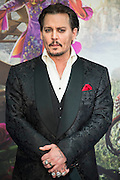 Johnny Depp - Alice Through the Looking Glass premiere - a Walt Disney American fantasy adventure film directed by James Bobin, written by Linda Woolverton and produced by Tim Burton. It is based on Through the Looking-Glass by Lewis Carroll and is the sequel to the 2010 film Alice in Wonderland. The film stars Johnny Depp, Anne Hathaway, Mia Wasikowska, Rhys Ifans, Helena Bonham Carter, and Sacha Baron Cohen and features the voices of Alan Rickman, Stephen Fry, Michael Sheen, and Timothy Spall.