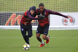 England's Jamie Vardy (left) and Joe Gomez during the training session at St George's Park, Burton.