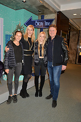 Left to right, FRANCESCA MOUFARRIGE, her mother TANIA BRYER, MARISSA BARKER and her father ROD BARKER at the official opening of the 2014 Tiffany & Co.Christmas Shop on Bond Street, London on 16th November 2014.