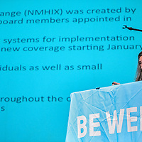 021914       Cable Hoover<br /> <br /> Roxane Spruce Bly of the New Mexico Health Insurance Exchange clicks through slides during a presentation at El Morro Theater in Gallup Thursday.