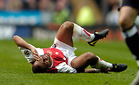 Fotball<br /> Photo. Jed Wee, Digitalsport<br /> NORWAY ONLY<br /> Newcastle United v Arsenal, FA Barclaycard Premiership, St James' Park, Newcastle. 11/04/2004.<br /> Arsenal's Ashley Cole goes down with an ankle injury and has to leave the field.