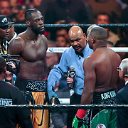 Deontay Wilder (L) faces off against Luis Ortiz during the WBC Heavyweight Championship boxing match at Barclays Center on Saturday, March 3, 2018 in Brooklyn, New York. Wilder would win the bout by knockout in the tenth round to retain the title and move to 40-0. (Alex Menendez via AP)