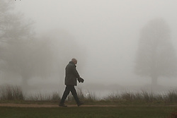 © Licensed to London News Pictures. 05/02/2020. London, UK.  A man walks through a foggy Bushy Park in south west London. Photo credit: Peter Macdiarmid/LNP