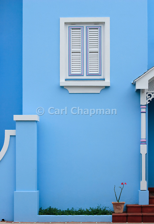White wooden window shutter on blue house - Rockley, Barbados <br /> <br /> Editions:- Open Edition Print / Stock Image
