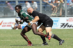 DJ Forbes of New Zealand tackles Ronald Mayers of Guyana during the XIX Commonwealth Games 7s rugby match between New Zealand and Guyana held at The Delhi University in New Delhi, India on the  11 October 2010..Photo by:  Ron Gaunt/photosport.co.nz