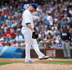 September 2, 2017 - Chicago, IL, USA - Chicago Cubs starting pitcher Jon Lester looks down after he gave up a two-run home run to the Atlanta Braves' Freddie Freeman during the third inning at Wrigley Field in Chicago on Saturday Sept., 2, 2017. (Credit Image: © Nuccio Dinuzzo/TNS via ZUMA Wire)