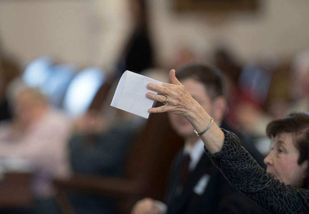 Austin Texas December 19, 2016: An Elector casts a ballot as Texas electors to the U.S. Electoral College meet at the Texas Capitol to cast votes for President Donald Trump and Vice-President Mike Pence.  Hundreds of protesters chanted outside the Capitol during the vote.
