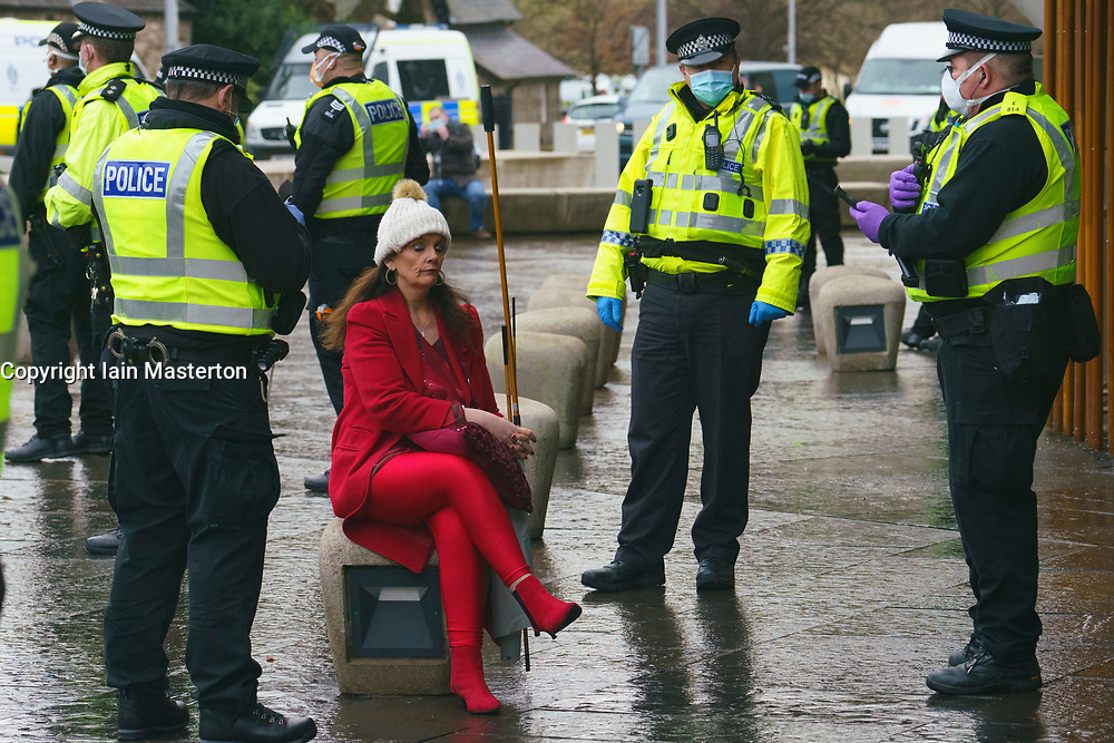 Edinburgh, Scotland, UK. 11 January 2020. Protester arrested in violent scenes at anti lockdown demonstration at Scottish Parliament in Edinburgh today. Several protesters took part but  a heavy and aggressive police presence prevented demonstration and planned march to Bute House. During national Covid-19 lockdown such protests are illegal and police advised people not to attend the demonstration.  Pic; Protester is charged under lockdown regulations.Iain Masterton/Alamy Live News