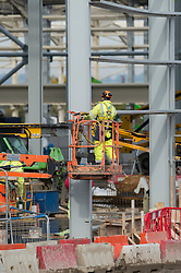 © Licensed to London News Pictures. 08/11/2013. Basildon, UK. Workers  constructing a new waste recycling and incinerator plant in Basildon, Essex which is due to go operational in 2017. The latest figures from the ONS (Office for National Statistics) released this morning show that in Q3 and September, construction output grew by 1.7% revised down from 2.5%. Photo credit : Simon Ford/LNP