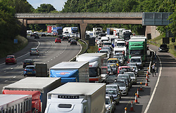 File photo dated 18/07/15 of congestion on the M6. More than 10 million leisure journeys are expected on Britain's roads between Friday and Monday as motorists embark on a getaway for the May Day bank holiday.