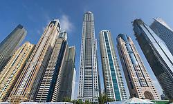 Daytime skyline of many modern skyscrapers in Marina district of Dubai United Arab Emirates