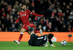 Liverpool's Mohamed Salah (left) has a shot saved by West Bromwich Albion goalkeeper Ben Foster (bottom) moments before team-mate Roberto Firmino (not in picture) scores his side's first goal of the game during the Emirates FA Cup, fourth round match at Anfield, Liverpool.