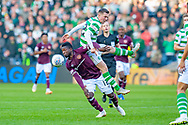 Callum McGregor(#42) of Celtic FC jumps on top of Danny Amankwaa (#12) of Heart of Midlothian during the Betfred League Cup semi-final match between Heart of Midlothian FC and Celtic FC at the BT Murrayfield Stadium, Edinburgh, Scotland on 28 October 2018.
