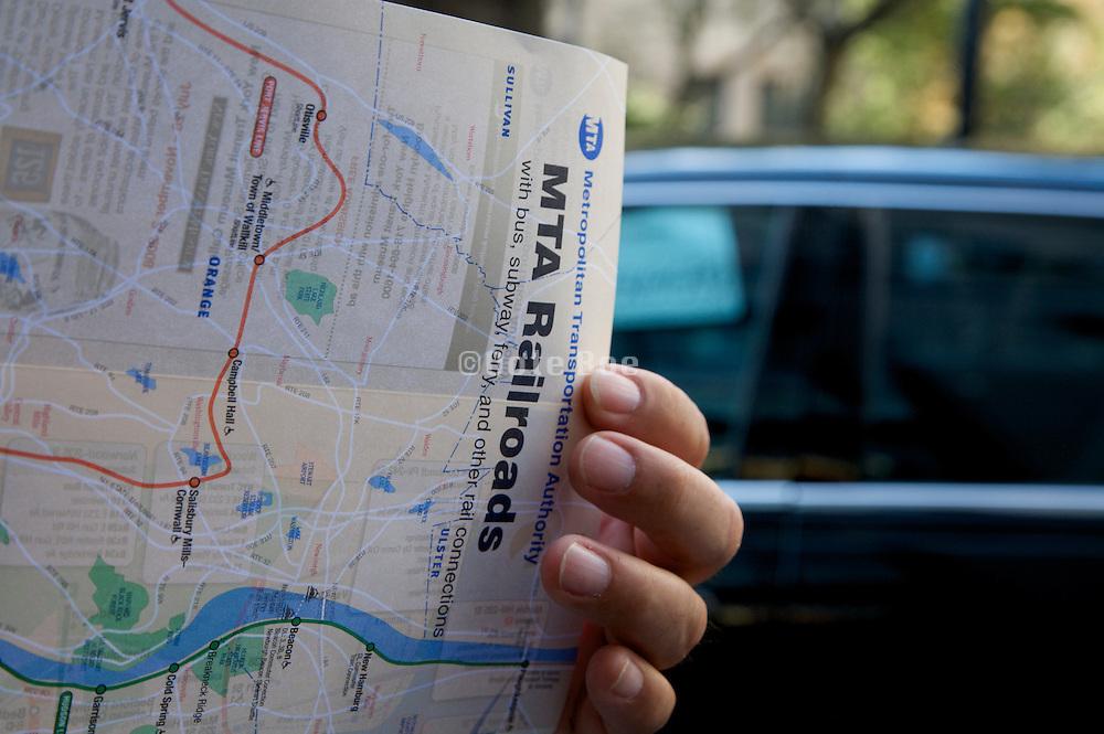 tourist studying the New York City MTA railroad map