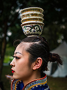25 JANUARY 2017 - BANGKOK, THAILAND:        A Chinese performer waits to go on stage during Chinese New Year, also called Tet, celebrations in Lumpini Park in Bangkok. 2017 is the Year of the Rooster in the Chinese zodiac. This year's Lunar New Year festivities in Bangkok were toned down because many people are still mourning the death Bhumibol Adulyadej, the Late King of Thailand, who died on Oct 13, 2016. PHOTO BY JACK KURTZ