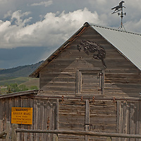 A sign on a barn near McAllister, Montana, warns of bears that do not live nearby.