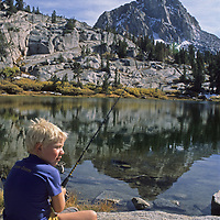 A youngster fishes in Emerald Lake, above Bishop, California in the Sierra Nevada.