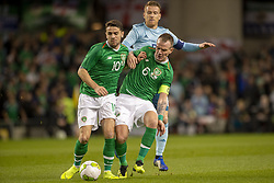 November 15, 2018 - Dublin, Ireland - Robbie Brady and Glenn Whelan of Ireland fight for the ball with Seven Davis of N.Ireland during the International Friendly match between Republic of Ireland and Northern Ireland at Aviva Stadium in Dublin, Ireland on November 15, 2018  (Credit Image: © Andrew Surma/NurPhoto via ZUMA Press)