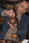Chinese Tea Ceremony. Male server prepares the traditional tea. photographed in Chengdu, Sichuan, China