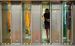 RWE employees who work in the reactor chamber, are required to pass through a radiation screening station at the RWE nuclear power plant, in Lingen, Germany, on Tuesday, Sept. 6, 2011. (Photo © Jock Fistick)