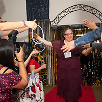 Rolanda Thompson is greeted by high-fives as she struts the red carpet at Night to Shine, Friday, Feb. 7 at the New Life Christian Assembly in Pinedale. 75 guests attended the prom and each one was introduced by Pastor Nathan Lynch before walking the red carpet.