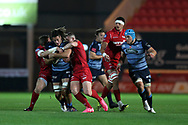Josh Navidi of Cardiff Blues © is stopped by Hadleigh Parkes (l) and Scott Williams ® of the Scarlets. Guinness Pro14 rugby match, Scarlets v Cardiff Blues  at the Parc y Scarlets in Llanelli, West Wales on Saturday 28th October 2017.<br /> pic by  Andrew Orchard, Andrew Orchard sports photography.