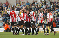 Photo: Leigh Quinnell.<br /> Wycombe Wanderers v Cheltenham Town. Coca Cola League 2, Play off Semi Final. 13/05/2006. Cheltenham players congratulate John Finnigan(centre) on his goal.