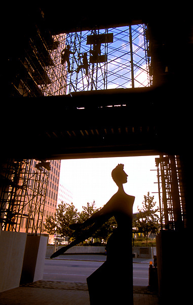 Stock photo of workmen on scaffolding overlooking a sculpture during new construction at Jones Hall in Houston, Texas