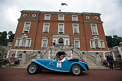 © Licensed to London News Pictures. 13/07/2015. Epsom, UK. PAUL COSBY and ANDY PULLAN ready their 1937 AC 16/80 March Special at the start line in front of Woodcote Park. The start of The Royal Automobile Club 1000 Mile Trial 2015 at Woodcote Park in Epsom, Surrey. The event, which starts and finishes at Woodcote Park, takes a fleet of over 40 classic cars from around the world, through a 1000 mile trial around the UK.  Photo credit: Ben Cawthra/LNP