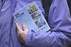 November 12, 2016 - Manchester, England, United Kingdom - A person holds a copy of the 'One Million Climate Jobs' pamplet which highlights alternative economic strategies for investment in renewable energy in order to grow local, national and global economic activity without using fossil fuels on November 12, 2016 in Manchester, England. (Credit Image: © Jonathan Nicholson/NurPhoto via ZUMA Press)