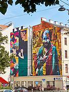 House Art, Austria. Vienna, Calle Libre street art festival.  'Laying Girl' (l.) by Kruella and 'Klimt mit Katze (Klimt with Cat)' by Kobra, Gra!ito #9800  (2018)
