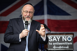© Licensed to London News Pictures . Manchester , UK . FILE PICTURE DATED 16/09/2018 of Chief Rabbi EPHRAIM MIRVIS amongst thousands of people attending a demonstration against rising anti-Semitism in British politics and society , at Cathedral Gardens in Manchester City Centre as today (14th November 2018) Josh Brogan has been handed a six month sentence for a racially aggravated public order offence after being seen performing a Nazi salute and shouting abuse at Jewish people at the demonstration . Photo credit : Joel Goodman/LNP<br /> <br /> For more information see https://www.manchestereveningnews.co.uk/news/greater-manchester-news/moment-racist-yob-arrested-after-15416089