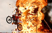 Gene Sullivan jumps his Honda XR650R dirt bike through a 12-foot-high wall of fire in a demonstration of his faith in Jesus Christ in Jackson, Wyoming. The stunt, performed by the former Evel Knievel bodyguard, is intended to represent what God and Jesus have done for mankind. It's performance follows a series of religious testimonies and songs praising God, inviting others to take him into their hearts. Sullivan performs the show, Jump For Jesus, for live audiences in several countries.