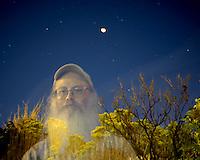 Accidental Ghostly Self Portrait Taken During a Lunar Eclipse. Boulder Colorado, 28-August-2007. Image taken with a Nikon D2xs and 14 mm f/2.8 lens (ISO 400, 14 mm, f/2.8, 30 sec).