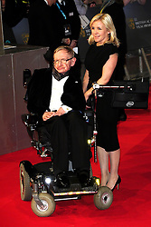 March 13, 2018 - FILE - STEPHEN HAWKING has died due to amyotrophic lateral sclerosis, a progressive neurodegenerative, he was 76. The British theoretical physicist was known for his groundbreaking work with black holes and relativity, and was the author of several popular science books including A Brief History of Time. PICTURED: Feb. 8, 2015 - London, England - Stephen Hawking and Lucy Hawking arriving at the EE British Academy Film Awards 2015 at the Royal Opera House on February 8 2015  in London  (Credit Image: © Famous/Ace Pictures/ZUMA Wire)