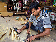 """30 AUGUST 2018 - BANGKOK, THAILAND: Artisans from Inda work on clay and straw statues of Ganesh, the Hindu """"overcomer of obstacles"""" at the Vishnu Temple in Bangkok. The statues will be sanctified and sent to Hindu temples throughout Thailand for the Ganesh Festival in September.     PHOTO BY JACK KURTZ"""