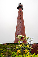 Norway, Vesteraalen. Andøya is the northernmost island in the archipelago of Vesterålen. The red lighthouse at Andenes.
