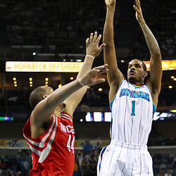 April 6, 2011; New Orleans, LA, USA; New Orleans Hornets small forward Trevor Ariza (1) shoots over Houston Rockets center Chuck Hayes (44) during the second quarter at the New Orleans Arena.   Mandatory Credit: Derick E. Hingle-US PRESSWIRE