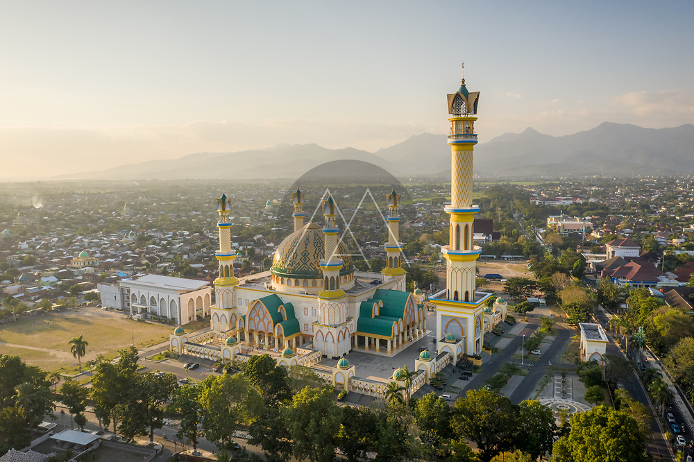 Aerial view of the beautiful Islamic center NTB, a colourful mosque with dome and traditional minarets in Mataram downtown, West Nusa Tenggara, Indonesia.