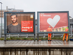 April 30, 2019 - Munich, Bavaria, Germany - Two. maintenance workers in Munich, Germany arrange advertising posters for the matchmaking portal Parship.com..The site is one of the largest online dating sites in Central Europa. (Credit Image: © Sachelle Babbar/ZUMA Wire)