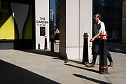 In the week that many more Londoners returned to their office workplaces after the Covid pandemic, City workers walk through sunlight and shadows in the City of London, the capital's financial district, on 8th September 2021, in London, England.