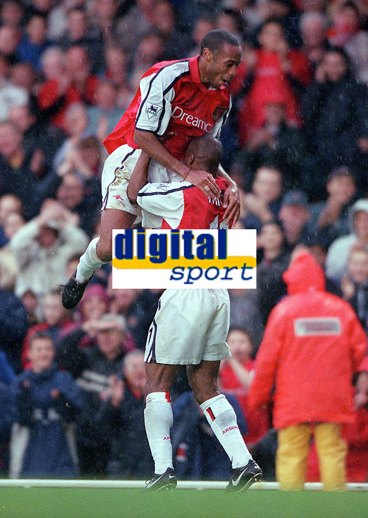 Sylvian Wiltord celebrates scoring the 3rd Arsenal goal with Thierry Henry. Arsenal v Manchester City, F.A.Carling Premiership, 28/10/2000. Credit Colorsport / Stuart MacFarlane.