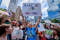 May 24, 2019 - New York, New York, United States - Hundreds of New York City students, young people and climate activists gathered at Columbus Circle for a rally followed by a march and die-in to Times Square on May 24, 2019 to join countries around the world in the second ever Global Climate Strike, demanding that NYC Mayor Bill DeBlasio follow the UK, Ireland and countless cities around the world who have declared a Climate Emergency. (Credit Image: © Erik Mcgregor/Pacific Press via ZUMA Wire)
