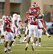 Arkansas linebackers Jerry Franklin (34) and Alonzo Highsmith (45) react to a play as safety Jerico Nelson (31) looks on during an NCAA college football game against Auburn on Saturday, Oct. 8, 2011, in Fayetteville, Ark. (AP Photo/Beth Hall)