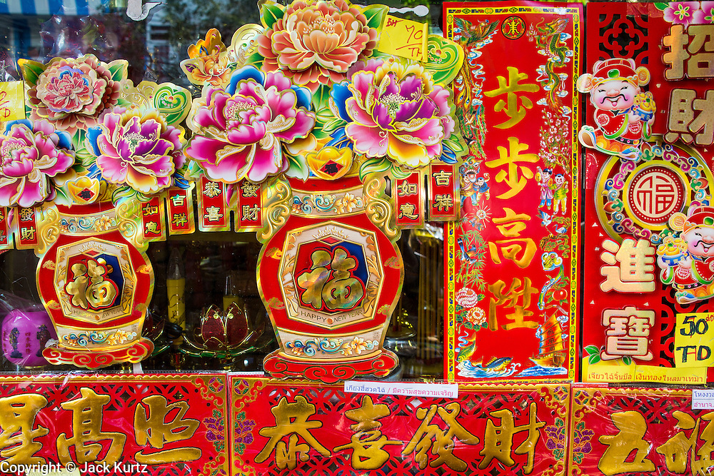 """22 JANUARY 2013 - BANGKOK, THAILAND:   Chinese New Year decorations on display in a shop on Charoen Krung Road in Bangkok's Chinatown district. Chinese New Year is not an official public holiday in Thailand, but it is one the biggest celebrations in the Bangkok, which has a large Chinese population. Chinese New Year is February 10 this year. It will be the """"Year of the Snake.""""    PHOTO BY JACK KURTZ"""